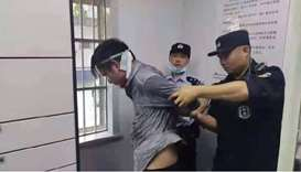 Police arrest the China knife attack suspect.