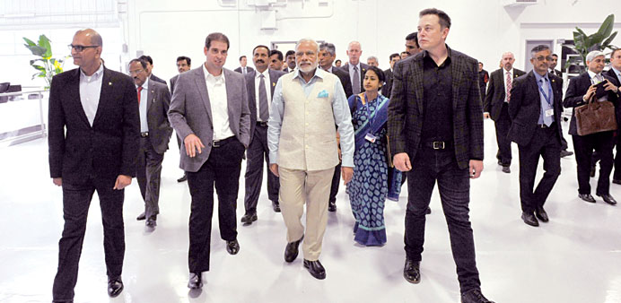 Prime Minister Narendra Modi is seen with Tesla Motors CEO Elon Musk during a tour of the company's