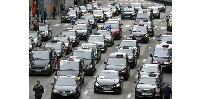 Taxi drivers from all over Europe line a street during a protest against Uber in central Brussels ye