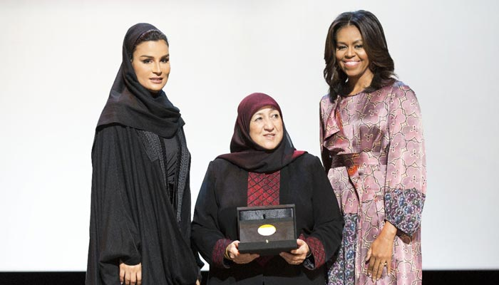 HH Sheikha Moza bint Nasser and US First Lady Michelle Obama with the recipient of the 2015 WISE Awa