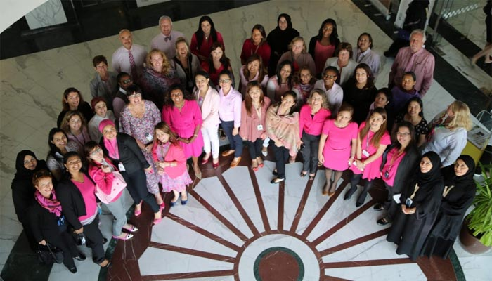 Sidra staff pose for the Think Pink campagin
