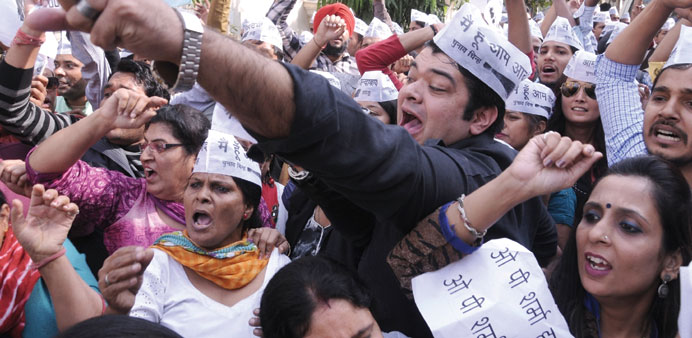AAP activists stage a demonstration against BJP lawmaker Sharma in New Delhi yesterday.