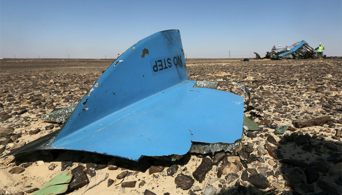 The debris from a Russian airliner is seen at its crash site at the Hassana area in Arish city, nort