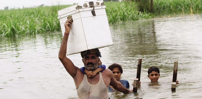 Flash floods in Pakistan damage roads and crops