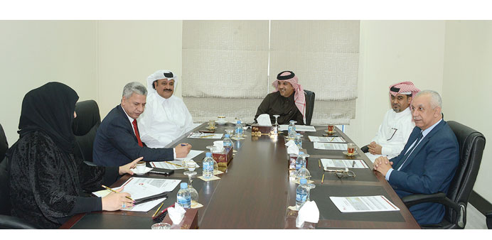 The QC tourism committee during a meeting.