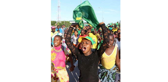 Supporters of Tanzania presidential candidate John Pombe Magufuli celebrate after he was declared th