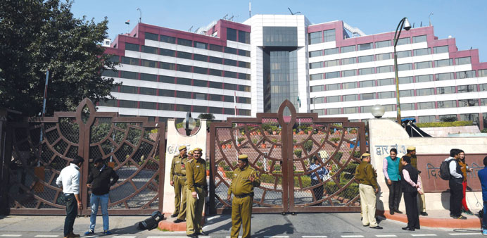 Police stand guard outside the Delhi Secretariat yesterday during a raid by the CBI.