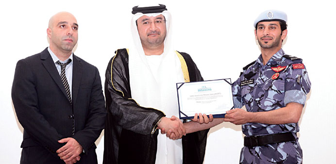 Lekhwiya officials displaying the certificate of 'Heavy' classification.