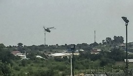 South Sudanese government attack helicopters hover over the Checkpoint district of the capital Juba