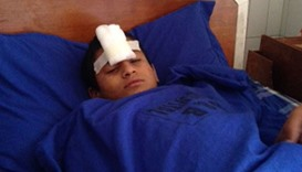 An injured student is getting treated at a hospital in Lalitpur.