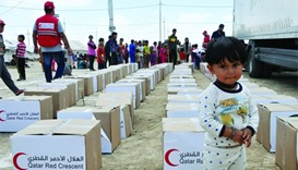QRCS distributes food packages to poor families in Iraq