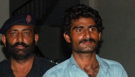 Wasim (R), the brother of slain social media celebrity Qandeel Baloch, is escorted by police