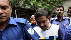 Bangladesh charges 38 with murder over garment factory collapse