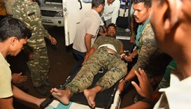 An injured Indian paramilitary personnel is brought to hospital following a Maoist attack, India
