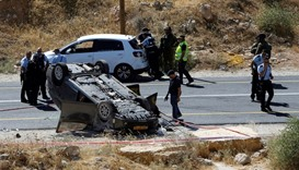 Israeli security forces gather at the scene following a shooting on an Israeli car near the West Ban
