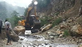 Bulldozers remove the debris from National Highway-94, Uttarakhand