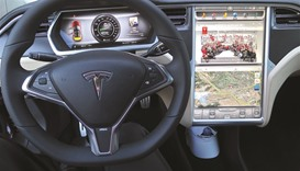 Tesla buys German auto firm to drive up production