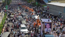 Thousands in funeral march for slain Cambodia activist