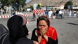 An Afghan woman weeps at the site of a suicide attack in Kabul, Afghanistan, on Saturday.