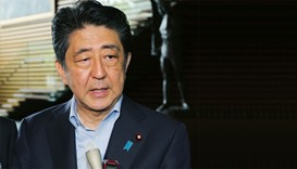 Japanese Prime Minister Shinzo Abe speaks to journalists after a cabinet meeting to talk about Dhaka