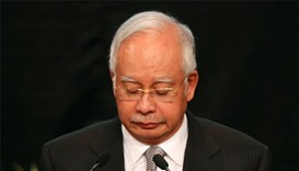 Malaysia's scandal-mired Najib hit with travel ban after poll loss