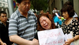Chinese families of MH370 victims protest decision to suspend search