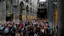 People attend a Mass in tribute to priest Jacques Hamel in the Rouen Cathedral on July 30, 2016.