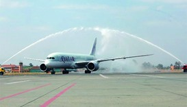 Flight QR1395 being welcomed with a water salute at Marrakech Menara Airport.