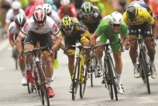 Cavendish sets new mark with narrow Tour stage victory
