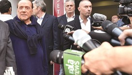 Ex-PM Berlusconi leaves hospital, cautious about his political future