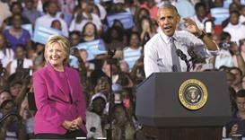 Obama joins Clinton on campaign trail at a rally