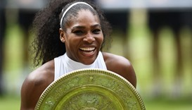 US player Serena Williams poses with the winner's trophy, the Venus Rosewater Dish