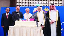 HE Mohamed Abdul Wahed Ali al-Hammadi and ambassador Alan Timbayan lead cutting of cake at the Phili