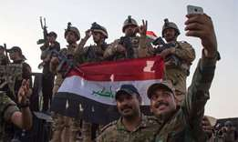 "Iraqi forces take a selfie in Mosul after the government announced the ""liberation"" of the city"