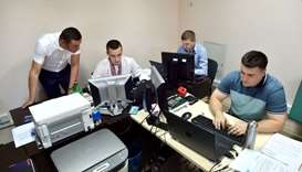 Officers of Ukrainian Cyberpolice Department work in an office in the department building in Kiev on