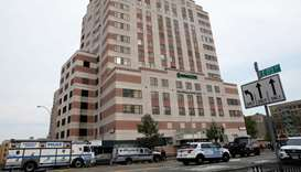 Gunman kills doctor, wounds 6 in NY hospital rampage