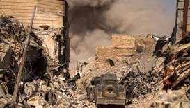 Iraqi forces clash with IS in Mosul days after victory