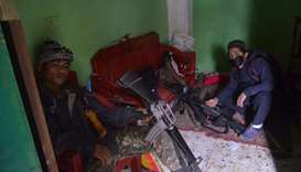 Militant members of the Maute group, an ISIS-affiliated group, inside a house in Marawi