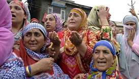 Indian Kashmiri women watch the funeral of slain rebel Aaquib Gul after a gunfight between rebels an