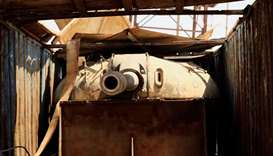 A tank inside a truck, made by Islamic State militants, to avoid attack of the plane is seen at Fede
