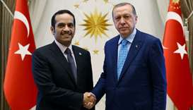 HE Sheikh Mohamed bin Abdulrahman al-Thani  (L) shaking hands with Turkey's President Recep Tayyip E