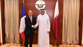HE Sheikh Mohamed bin Abdulrahman al-Thani shakes hands with French Minister of Foreign Affairs Jean