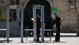 Israeli border policemen install metal detectors outside the Lion's Gate, a main entrance to Al-Aqsa