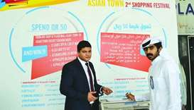 Asian expatriates named raffle draw winners