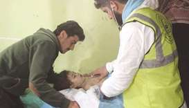 An unconscious Syrian child receives treatment at a hospital in Khan Sheikhun