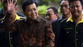 The speaker of Indonesia's parliament Setya Novanto waves as he arrives at Corruption Eradication Co
