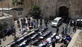 Muslim worshippers, who refuse to enter Al-Aqsa mosque compound due to newly-implemented security me
