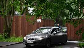 A man stands by his car as he leaves a settlement, which houses a US diplomatic recreational house,