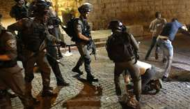 Israeli security forces (L) clash with Palestinian demonstrators (R) in Jerusalem's Old City yesterd
