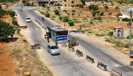 ":Members from a coalition of rebel groups called ""Jaish al Fateh"" man a checkpoint in Idlib city, Sy"